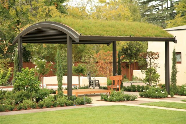 Focus on the green roof system on top of a patio shelter at a private residence